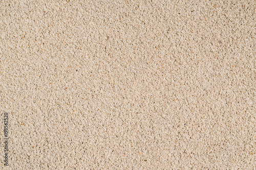 Cement color surface with fine stones, uneven texture, old, abstract background for print design