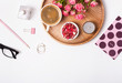 Feminine accessories, candies, coffee and roses on the white background,