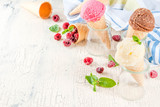 Summer sweet berries and desserts, various of ice cream flavor in cones pink (raspberry), vanilla and chocolate with mint on light concrete background copy space - 198590788