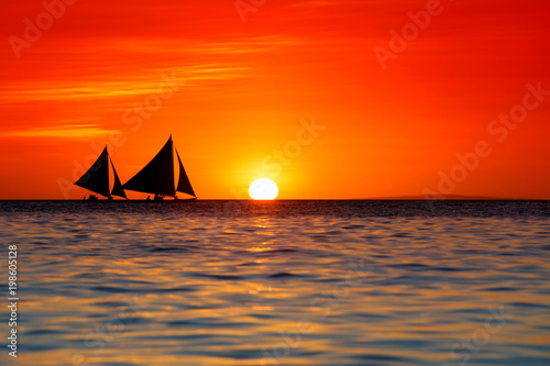 Fotobehang Rood Sailing and beautiful red sunset at Boracay Island, Philippines