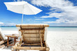 Chairs and parasol on tropical beach, Boracay Island, Philippines