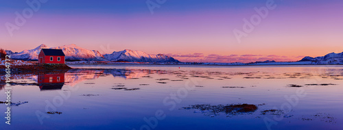 In de dag Ochtendgloren Landscape with beautiful winter lake, red rorbu house and snowy mountains at sunset at Lofoten Islands in Northern Norway. Panoramic view