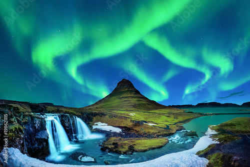 Northern Light, Aurora borealis at Kirkjufell in Iceland. Kirkjufell mountains in winter. - 198621115