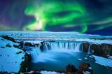 Fototapety Northern Light, Aurora borealis at Godafoss waterfall in winter Iceland.