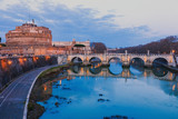 Italy, Rome, view of the Castle of Saint Angel, the Tiber River and the Bridge of Saint Angel, evening