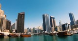 DUBAI, UNITED ARAB EMIRATES, MARCH 22 2018: Dubai Marina Architecture Time Lapse.  Dubai Marina Boat Ride Timelapse with Beautiful Architecture - 198634707