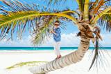 Little boy on palm tree
