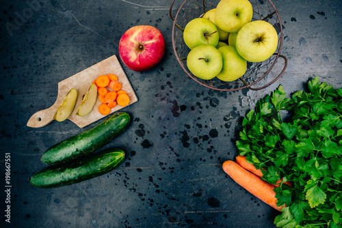 Fresh fruits and vegetables on black metal surface