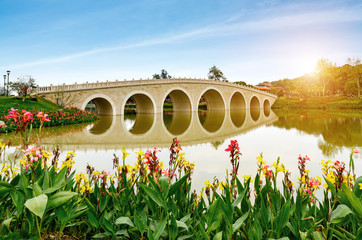 Old arch bridge on the lake in China