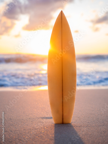Fotobehang Bali surfboard on the beach in sea shore at sunset time