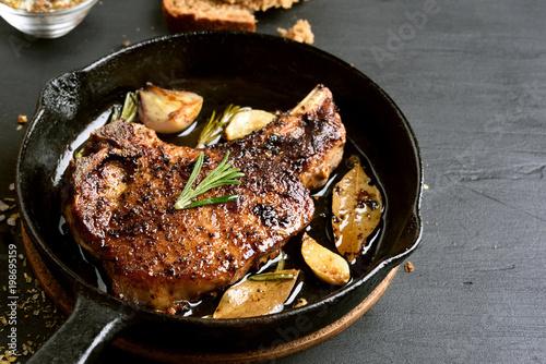 Foto op Plexiglas Steakhouse Pork steak in frying pan