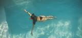 Woman swimming in the pool - 198695918