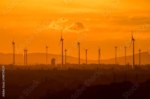 Foto op Plexiglas Oranje eclat Wind farm of wind turbines