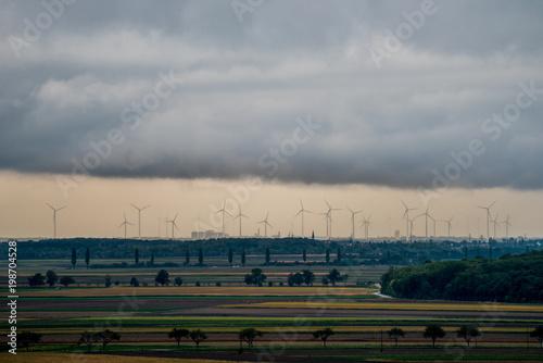 Fotobehang Bleke violet Wind farm of wind turbines