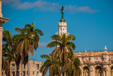 The Great Theater and palm trees closeup on blue sky background. Havana. Cuba