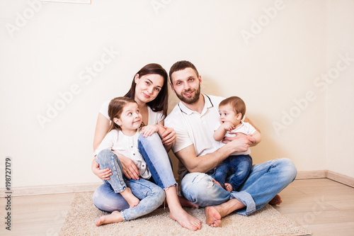Portrait of a beautiful young family