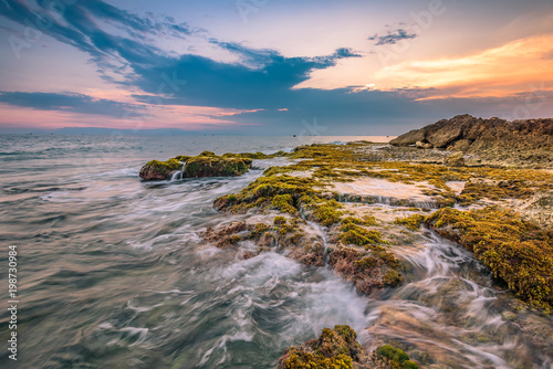 Foto op Plexiglas Ochtendgloren Sunrise on Hon Do rock beach in Ninh Thuan province, Vietnam.