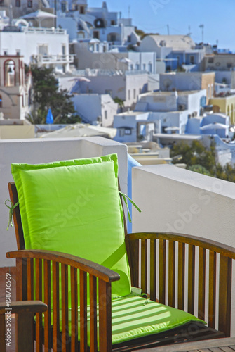 Tuinposter Santorini Green chair on luxury terrace, Santorini island, Greece