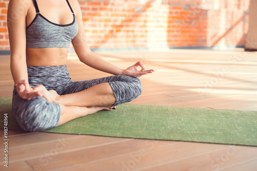Young girl in a lotus position