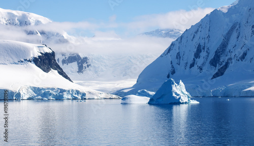 Fotobehang Antarctica Beautiful Neumayer Channel, Antarctica. Snowcapped mountains, icebergs, calm waters and blue skies