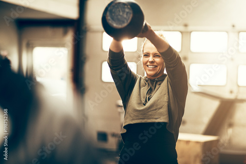 Fit young woman enjoying an exercise class at the gym