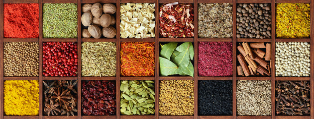 Spices in wooden box background © interpas