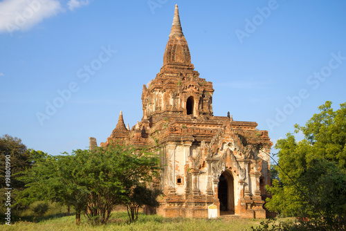 One of the Buddhist temples of ancient Bagan closeup on a Sunny day Poster