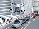 Fototapety White passenger drone flying over cars in heavy traffic jam. Concept for drone taxi. 3D rendering image.