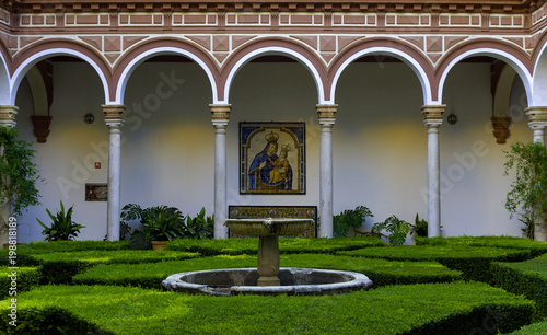 View of the courtyard garden and fountain of a building in the historic center of Seville. Spain