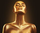 Fashion art golden skin woman portrait closeup. Gold, jewelry, accessories. Model girl with golden glamour shiny makeup - 198822947