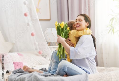 daughter is congratulating mom - 198847129
