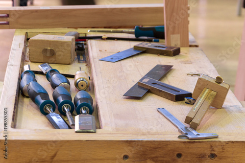 Workplace carpenter, workbench with a variety of carpentry tools.