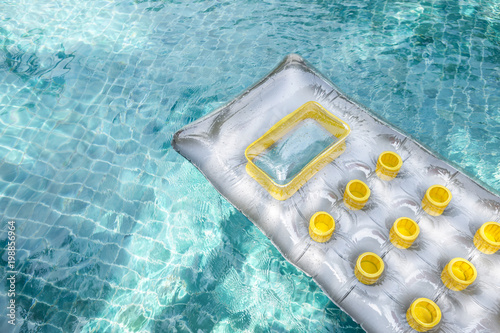 New air mattress floating on clear swimming pool water, summer concept, outdoor day light - 198856964