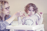 The two-year-old child is naughty and refuses to eat