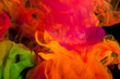 Abstraction of mix multicolored paints in water on a black background - 198857552