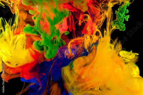 Abstraction of mix multicolored paints in water on a black background - 198857537