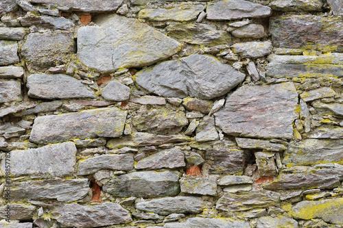Stara kamienna ściana z narysami jako tekstura