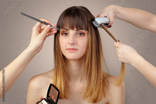 Portrait of young pretty woman at beautician and hairdresser  - 198857910