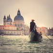 Gondolier in the Grand Canal of Venice, Italy