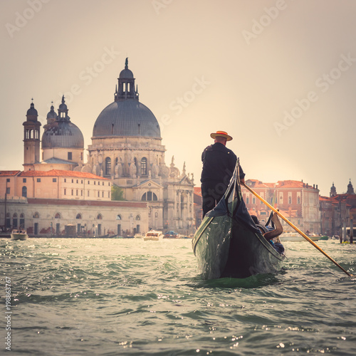 Gondolier in the Grand Canal of Venice, Italy - 198863767