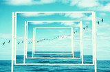 surreal enigmatic picture of flying birds and frame . beach landscape. - 198867120