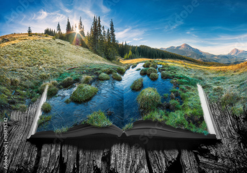 Alpine mountain valleyon the pages of an open book - 198875742
