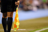 Line referee with flag
