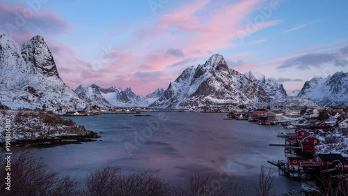 timelapse on a pretty morning with pink clouds moving over the iconic fishing village of reine in winterly norway © plpictures.com
