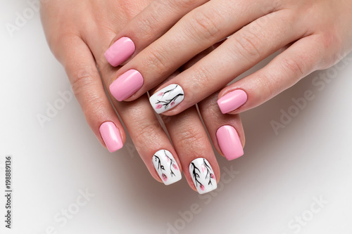Foto Spatwand Manicure delicate pink manicure with spring flowers on short square nails on a white background