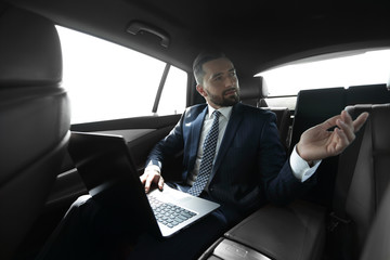 Confident businessman talking in car