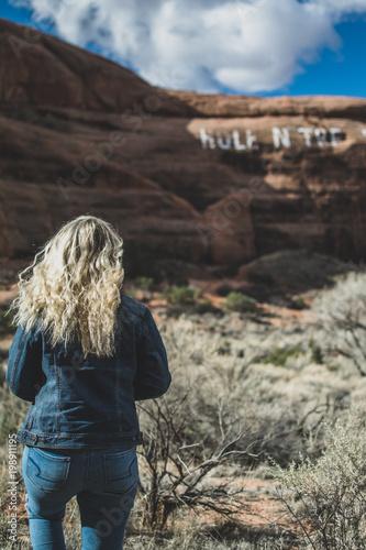 Fotobehang Bleke violet Girl Looking at Desert Canyon Landscape