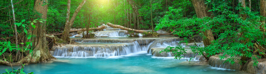 Panoramic beautiful deep forest waterfall in Thailand © yotrakbutda