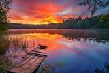Bright sunrise over forest lake - 198925751