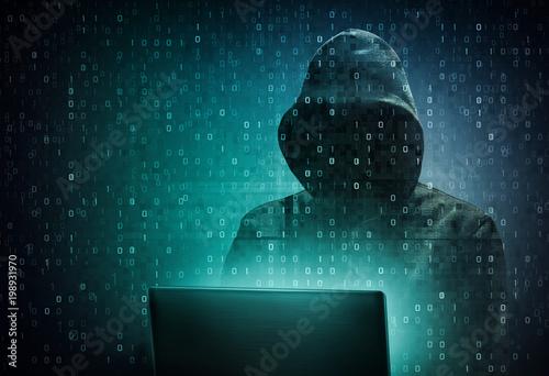 Leinwanddruck Bild  hacker over a screen with binary code
